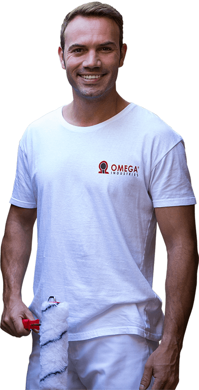 Omega Industries paint contractor holding a paint roller.