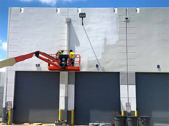 Commercial painters starting an exterior painting job.